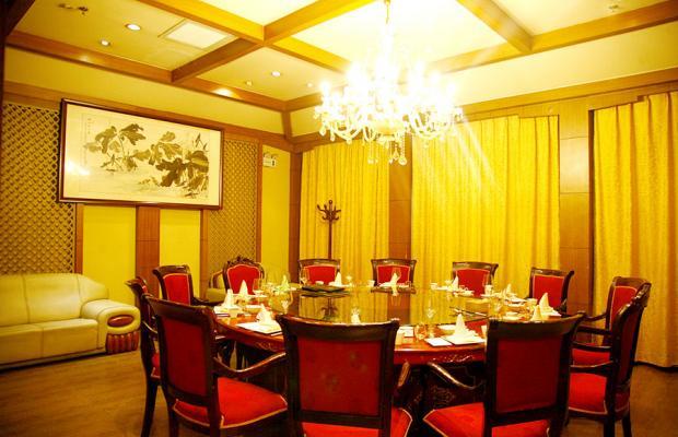 фото отеля Ming Ri Wuzhou изображение №5